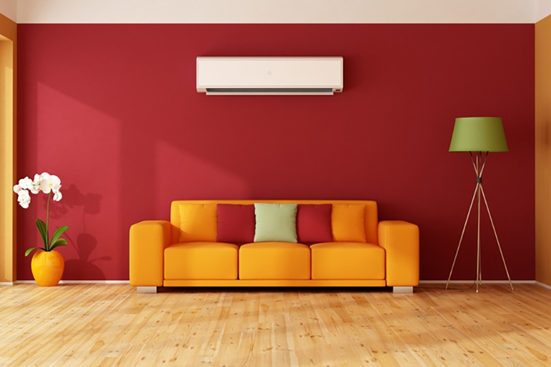 red and orange living room with ductless AC