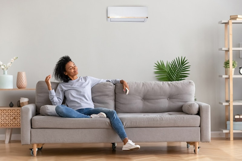 A woman relaxing on a couch | What Accessories Can Help With My Indoor Air Quality? | Wenatchee, WA