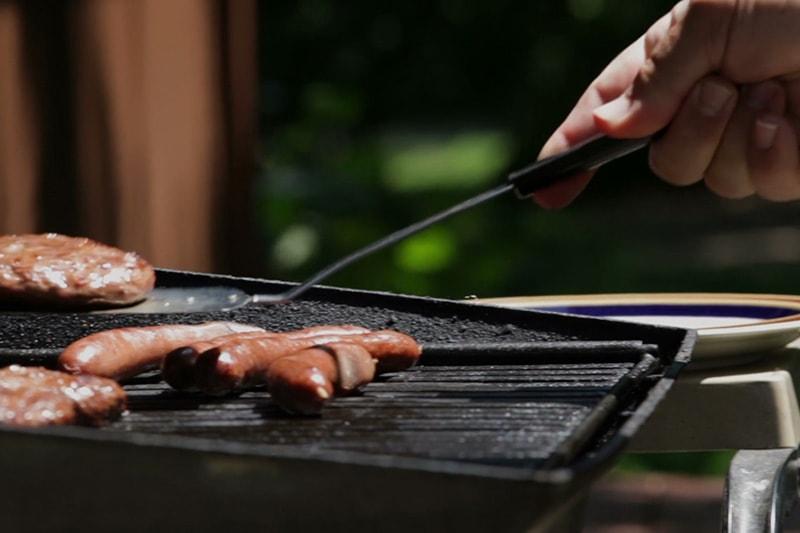 hang holding utensil over grill outside
